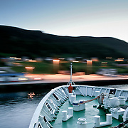 Three weeks aboard the Kong Harald. Hurtigruten, the Coastal Express. The ship accosting by night.