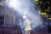 © Licensed to London News Pictures. 15/01/2015. Crowmarsh, UK Fire has engulfed council offices in Oxfordshire and two other buildings following a spate of suspected arson attacks overnight. A 47-year-old man has been arrested following the blaze at the South Oxfordshire District Council building in Crowmarsh Gifford.. Photo credit : Stephen Simpson/LNP