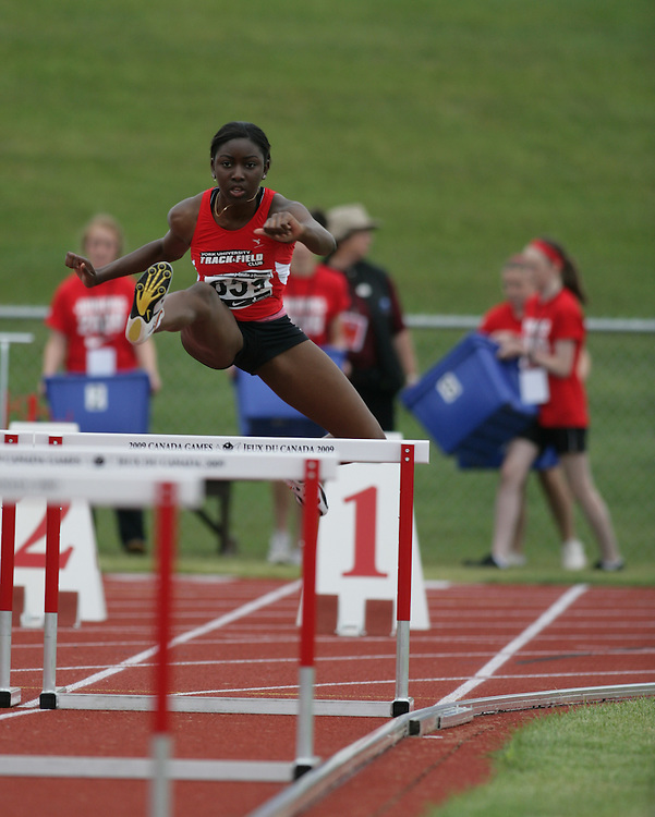 (Charlottetown, Prince Edward Island -- 20090717) Christa Acquah of York University Track & F competes in the sprint hurdles at the 2009 Canadian Junior Track & Field Championships at UPEI Alumni Canada Games Place on the campus of the University of Prince Edward Island, July 17-19, 2009.  Copyright Sean Burges / Mundo Sport Images , 2009...Mundo Sport Images has been contracted by Athletics Canada to provide images to the media.
