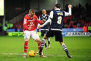 Jason Demetriou of Walsall FC on his way past Edward Upson of Millwall FC during the Sky Bet League 1 match between Walsall and Millwall at the Banks's Stadium, Walsall, England on 6 February 2016. Photo by Mike Sheridan.