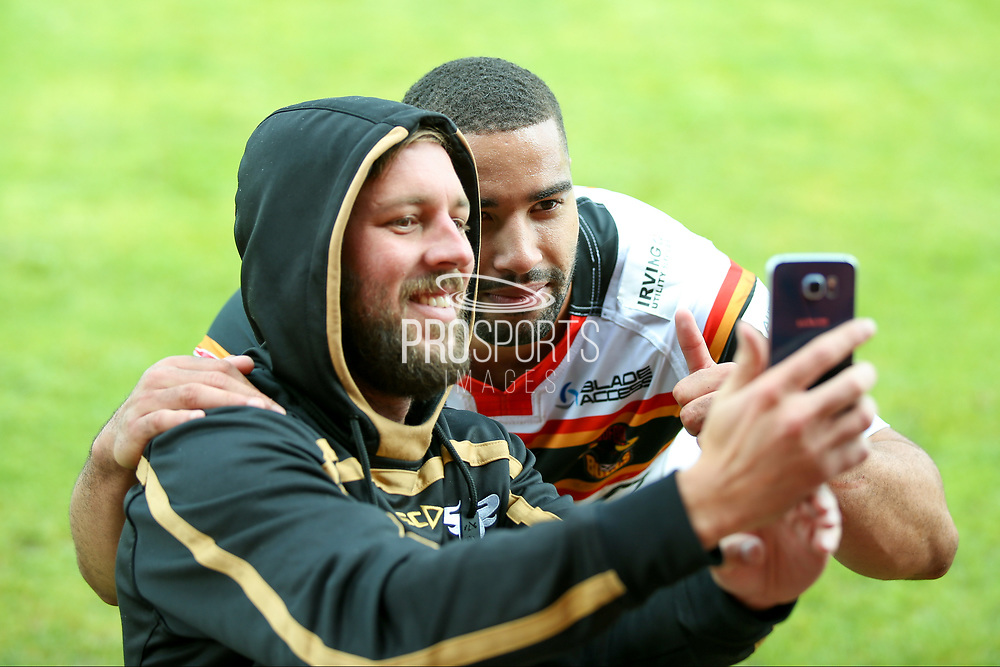 Bradford Bulls winger Omari Caro (18) has a selfie with a fan during the Kingstone Press Championship match between Dewsbury Rams and Bradford Bulls at the Tetley's Stadium, Dewsbury, United Kingdom on 10 September 2017. Photo by Simon Davies.