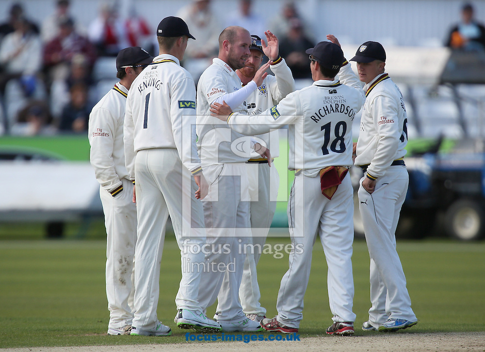 Picture by Paul Gaythorpe/Focus Images Ltd +447771 871632<br /> 18/09/2013<br /> Durham County Cricket Club players congratulate bowler Chris Rushworth on taking the wicket of James Taylor of Nottinghamshire County Cricket Club during the LV County Championship Div One match at Emirates Durham ICG, Chester-le-Street.