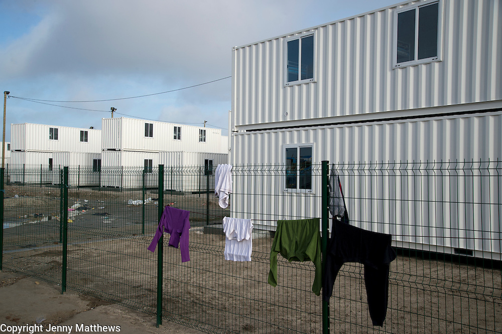 France, Calais. 'Jungle' camp for refugees. New container housing for refugees provided by the French government but many are reluctant to move there.