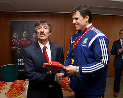 CARDIFF, WALES - Tuesday, March 24, 2015: Wales Veterans' Mick Algieri is presented with a cap by Wales national team manager Chris Coleman. (Pic by David Rawcliffe/Propaganda)