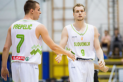 Klemen Prepelic of Slovenia and Jaka Blazic of Slovenia during friendly basketball match between National teams of Slovenia and Ukraine at day 3 of Adecco Cup 2014, on July 26, 2014 in Rogaska Slatina, Slovenia. Photo by Vid Ponikvar / Sportida.com