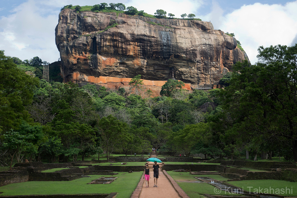 Visitors walk on the path to the Lion Rock in Sigiriya, Sri Lanka on January 5, 2016. The ruins of ancient city created in the 5th century A.C by King Kashyapa, who built his palace on top of the rock, become one of the UNESCO World Heritage Site in 1982. (Photo by Kuni Takahashi)