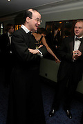 Father Rupert McHardy and  Christopher Hutton. White Knights Ball, Grosvenor House Hotel 7 January 2005. ONE TIME USE ONLY - DO NOT ARCHIVE  © Copyright Photograph by Dafydd Jones 66 Stockwell Park Rd. London SW9 0DA Tel 020 7733 0108 www.dafjones.com