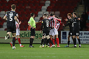 Scuffle after Chris Lines's foul on Jake Doyle-Hayes   during the EFL Sky Bet League 2 match between Cheltenham Town and Northampton Town at Jonny Rocks Stadium, Cheltenham, England on 25 February 2020.