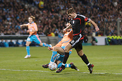 MARSEILLE, FRANCE - Tuesday, December 11, 2007: Liverpool's captain Steven Gerrard MBE is brought down by Olympique de Marseille's Gael Givet for a penalty during the final UEFA Champions League Group A match at the Stade Velodrome. (Photo by David Rawcliffe/Propaganda)
