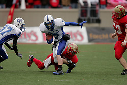 Bullitt East hosted Bell County in the Class 4A KHSAA Commonwealth Gridiron Bowl on Saturday, Dec. 13, 2008, at Papa John's Cardinal Stadium in Louisville, Ky. Bell County's Matt Raines, right, is tackled by Bullitt East's Ricky Gray. (photo by Jonathan Palmer)