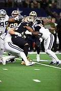 New Orleans Saints running back Mark Ingram II (22) gets gang tackled for no gain by Dallas Cowboys defensive end Demarcus Lawrence (90) and Dallas Cowboys defensive tackle Tyrone Crawford (98) in the second quarter during the NFL week 13 regular season football game against the Dallas Cowboys on Thursday, Nov. 29, 2018 in Arlington, Tex. The Cowboys won the game 13-10. (©Paul Anthony Spinelli)