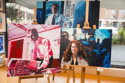 "© Licensed to London News Pictures. 27/06/2014. London, UK. Three oil on canvas portraits showing: Piers Morgan, former editor of the Daily Mirror titled ""Britain's got talent"" (top), Kelvin MacKenzie, former editor of The Sun titled ""We need to talk about Kelvin"" (left), Rebekah Brooks, former editor of the News of the World titled ""Great day for red tops"" (right) in the Alexander Miles Gallery in St Katherine Docks, close to the News UK site in Wapping, East London. Gallery owner and curator Alex Miles says that the anonymous artist is a current and long standing senior member of editorial staff at News UK and that he has painted these portraits of his subjects as he has seen them for many years in the newspaper working environment. The artist, who wishes to remain anonymous at the present time is using a 'nom de plume' of Mark Felt. Photo credit : Vickie Flores/LNP."