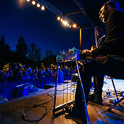 Robert Earl Keen performs to a packed crowd in Jackson, Wyoming. Portrait - Marty Muse playing steel guitar.
