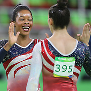 Gymnastics - Olympics: Day 4 Gabrielle Douglas of the United States and Alexandra Raisman of the United States high five and embrace after winning the gold medal during the Artistic Gymnastics Women's Team Final at the Rio Olympic Arena on August 9, 2016 in Rio de Janeiro, Brazil. (Photo by Tim Clayton/Corbis via Getty Images)
