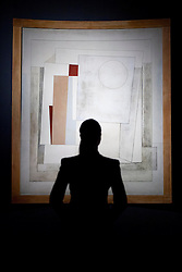 © Licensed to London News Pictures. 10/12/2012. London, UK. A member of Christie's staff looks at Ben Nicholson's 'October 1949 (Composition Rangitane)' (1949) (est. GB£1,000,000-1,500,000) at the auction houses King Street premises in London today (10/12/12). The evening auction, entitled 'Rule Britannia', and featuring over 185 lots by Britain's most influential modern artists, takes place on Wednesday the 13th Of December. Photo credit: Matt Cetti-Roberts/LNP