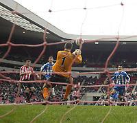 Photo: Andrew Unwin.<br />Sunderland v Wigan Athletic. The Barclays Premiership. 11/03/2006.<br />Wigan's goalkeeper, John Filan (C), saves from Sunderland's Kevin Kyle (L).