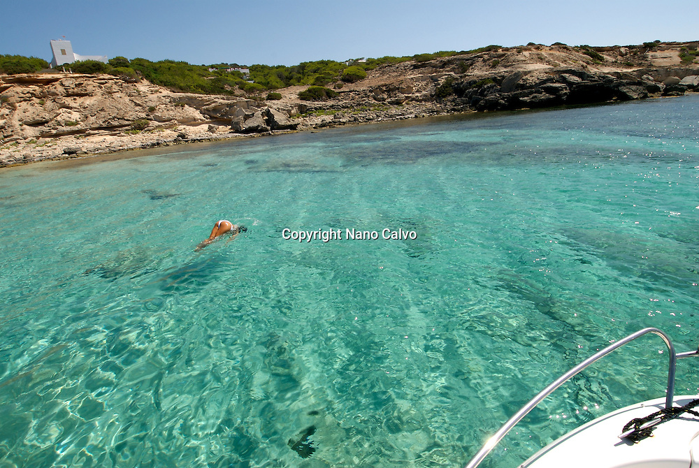 Amazing clear waters of Mitjorn, in the paradisiac island of Formentera. <br /> <br /> Formentera is the smallest and southernmost island of the Illes Piti&uuml;ses group (which includes Ibiza and Formentera) and belongs to the Balearic Islands autonomous community (Spain). It is 19 kilometres (12 mi) long and is located approximately 6 kilometres (4 mi) south of Ibiza in the Mediterranean Sea. Its major villages are Sant Francesc Xavier, Sant Ferran de ses Roques, El Pilar de la Mola and La Savina.