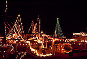 boats in marina with Christmas decorations and lights; holiday; festive; winter,