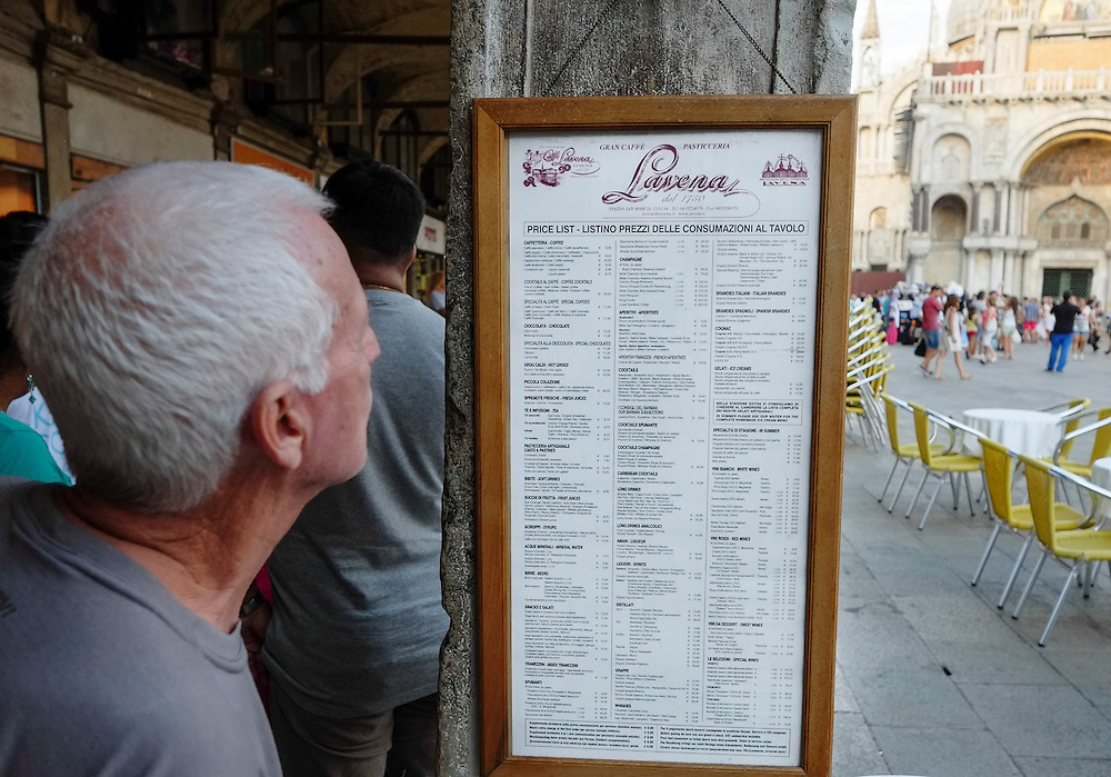 Venice August 20 A tourist studies the Caffe Lavena Menu. A group of Italian tourists were horrified to be charged the equivalent of £85 for four espresso coffees laced with liqueurs in the very central Saint Mark's Square in  Venice.