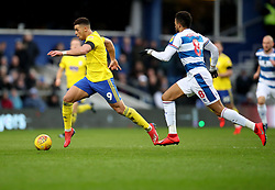 Birmingham City's Che Adams and Queen Park Rangers Jordan Cousins during the Sky Bet Championship match at Loftus Road London