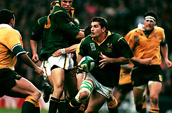 South Africa's Joost Van Der Westhuizen bursts through the Australian defence and looks around for support.