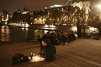 people partyiing on a Saturday night on the Pont des Arts, Paris