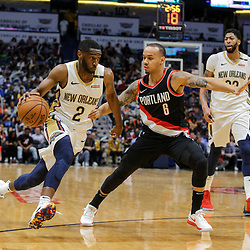 Mar 27, 2018; New Orleans, LA, USA; New Orleans Pelicans guard Ian Clark (2) drives past Portland Trail Blazers guard Shabazz Napier (6) during the first quarter at the Smoothie King Center. Mandatory Credit: Derick E. Hingle-USA TODAY Sports