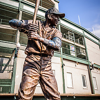 "Ernie Banks statue at Wrigley Field. Known a ""Mr. Cub"" Ernie Banks was a first baseman for the Chicago Cubs and in the Baseball Hall of Fame. Wrigley Field is home of the Chicago Cubs and was built in 1914 making it one of the oldest baseball stadiums in the United States."