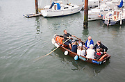 Small rowing boat ferry service across the harbour, Weymouth, Dorset, England, UK