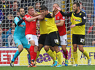 Picture by David Horn/Focus Images Ltd +44 7545 970036<br /> 14/09/2013<br /> Davide Faraoni (4th right) of Watford and Simon Church of Charlton Athletic (2nd left) get physical during the Sky Bet Championship match at Vicarage Road, Watford.