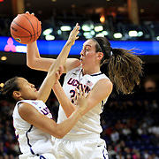 Breanna Stewart, (right), UConn, collides with team mate Saniya Chong as she pulls in a rebound during the UConn Vs DePaul, NCAA Women's College basketball game at Webster Bank Arena, Bridgeport, Connecticut, USA. 19th December 2014