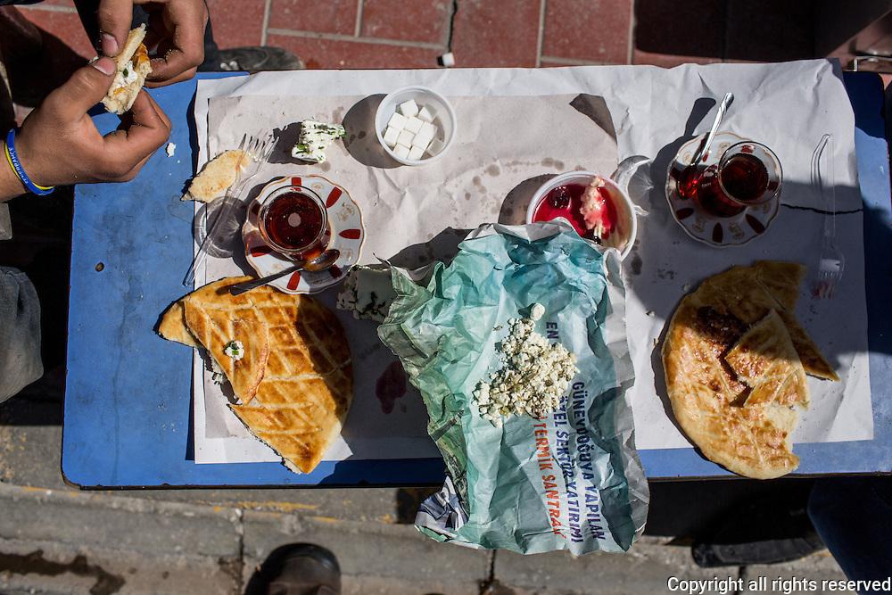 Shop owner's breakfast. Corek (salted yeast bread), kaymak (clotted cream) with preserves, cheese, tea. Van, Turkey