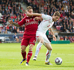 AALBORG, DENMARK - Saturday, June 11, 2011: Denmark's Nicki Bille Nielsen (Villarreal CF) and Switzerland's Jonathan Rossini (UP Sampdoria) during the UEFA Under-21 Championship Denmark 2011 Group A match at the Aalborg Stadion. (Photo by Vegard Grott/Propaganda)