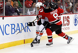 Oct 3, 2009; Newark, NJ, USA; New Jersey Devils left wing Zach Parise (9) hits Philadelphia Flyers defenseman Chris Pronger (20) during the second period at the Prudential Center.