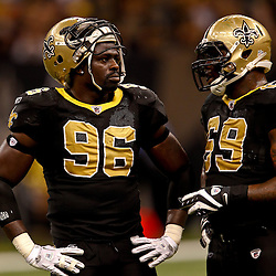 November 21, 2010; New Orleans, LA, USA; New Orleans Saints defensive end Alex Brown (96) talks with defensive lineman Anthony Hargrove (69) during the second half against the Seattle Seahawks at the Louisiana Superdome. The Saints defeated the Seahawks 34-19. Mandatory Credit: Derick E. Hingle