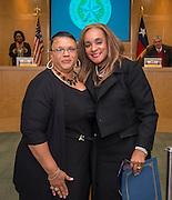 Houston ISD Board of Trustees president Rhonda Skillern-Jones, right, recognizes retired Lanier Middle school teacher Edith Moore, left, during a board meeting January 15, 2015.