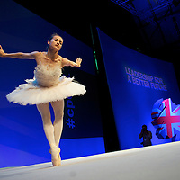 Ballet dancer ELENA GLURDJIDZE performs during the Conservatives Party Conference at Manchester Central.