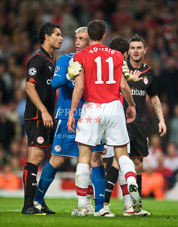 LONDON, ENGLAND - TUESDAY, SEPTEMBER 29th, 2009: Arsenal's Robin Van Persie clashes with Olympiakos' Michal Zewlakow during the UEFA Champions League Group H match at the Emirates Stadium. (Photo by Chris Brunskill/Propaganda)