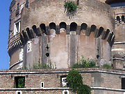 Detail from the The Mausoleum of Hadrian, known as the Castel St Angelo a towering cylindrical building in Parco Adriano, Rome, Italy. It was commissioned by the Roman Emperor Hadrian as a mausoleum for himself and his family. The building was later used by the popes as a fortress and castle, and is now a museum. It was built on the right bank of the Tiber, between 135 AD and 139 AD.
