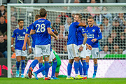 James Maddison (#10) of Leicester City is mobbed by team mates after he scores a deflected goal during the EFL Cup match between Newcastle United and Leicester City at St. James's Park, Newcastle, England on 28 August 2019.