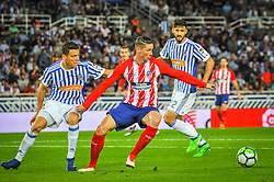 April 19, 2018 - San Sebastian, Spain - Fernando Torres of Atletico Madrid duels for the ball with Hector Moreno of Real Sociedad during the Spanish league football match between Real Sociedad and Atletico Madrid at the Anoeta Stadium on 19 April 2018 in San Sebastian, Spain  (Credit Image: © Jose Ignacio Unanue/NurPhoto via ZUMA Press)