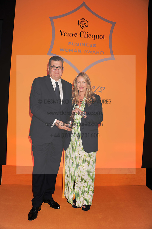 Winner of the Veuve Clicquot Business Woman of the Year Award ANYA HINDMARCH and JEAN-MARC LACAVE president of Veuve Clicquotat the annual Veuve Clicquot Business Woman of the Year Award this year celebrating it's 40th year, held at Claridge's, Brook Street, London on 18th April 2012.
