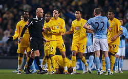 MANCHESTER, ENGLAND - Tuesday, December 18, 2007: Tottenham Hotspur's players crowd round referee Steve Bennett after he sent off Didier Zakora during the League Cup Quarter Final match against Manchester City at the City of Manchester Stadium. (Photo by David Rawcliffe/Propaganda)