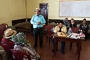 Representatives of the Association for Justice and Reconciliation (AJR) and the Guatemalan human rights group CALDH, brief AJR members on developments with the legal process following recent arrests in the genocide cases. <br /> The AJR is an association of survivors of massacres committed during the armed conflict.<br /> Nebaq, El Quiche, Guatemala, October 2011.
