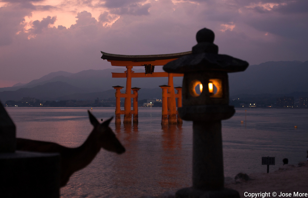 Itsukushima is an island in the western part of the Inland Sea of Japan, northwest of Hiroshima Bay. It is popularly known as Miyajima, the Shrine Island. The Itsukushima Shrine, a UNESCO World Heritage Site. During low tide visitors walk out to the large torii serves as the entrance to the popular Shinto Temple. <br /> Photography by Jose More