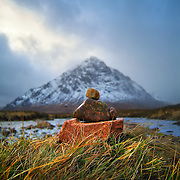 Stones piled on Rannoch moor with the herdsman Buachaille Etive Mòr in the background, Scotland