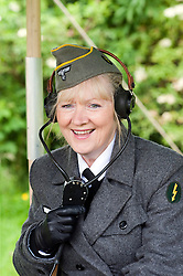 reenactor dressed as German army female signals auxiliary (Nachrichtenheflrennin des heeres) also nicknamed Blitzm&auml;dchen or lightening girls because of the signals insignia on their uniforms. <br />