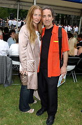HARRY SHEARER the voice of Mr Burns in The Simpsons and his wife JUDITH OWEN at the annual House of Lords v House of Commons tug of war match in aid of  of  Macmillan Cancer Relief on 21st June 2005.  A drinks reception was held in College Gardens followd by the tug of war on Victoria Tower Gardens, London.                                 <br />