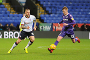 Bolton Wanderers Defender, David Wheater (31) and Stoke City Midfielder, Sam Clucas (22) during the EFL Sky Bet Championship match between Bolton Wanderers and Stoke City at the Macron Stadium, Bolton, England on 29 December 2018.