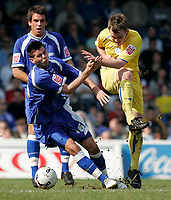 Photo: Mike Greenslade..Cardiff City v Sheffield Wednesday..Coca Cola Championship League..07.04.07..Ninian Park..KO 3pm...Cardiff's Joe Ledley looks to stop Owls midfielder Glen Whelan